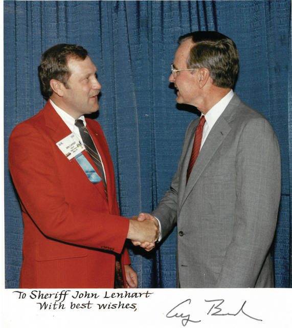 Shelby County Sheriff John Lenhart met President George H.W. Bush in 1990 at the National Sheriffs' Association conference.