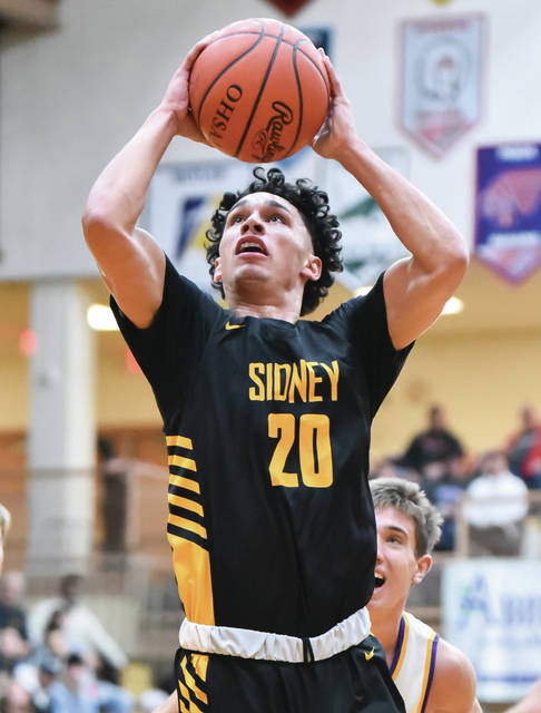 Sidney senior guard Andre Gordon shoots during a Greater Western Ohio Conference American North Division game on Tuesday at Butler's Student Activity Center.