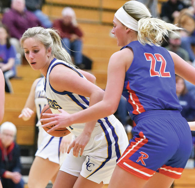 Lehman Catholic's Carly Edwards looks get down the lane with pressure from Riverside's Shelby Giles during a Northwest Central Conference game on Thursday in Sidney. Edwards led Lehman with 12 points.