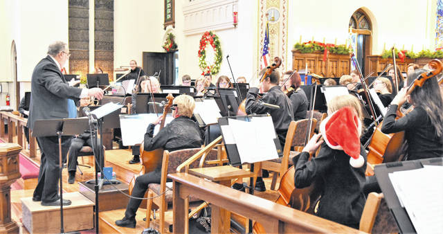 "John Streb conducts The Upper Valley Community Orchestra at St Johns Lutheran Church Sunday afternoon. The theme of the winter concert is ""Christmas Nostalgia."""
