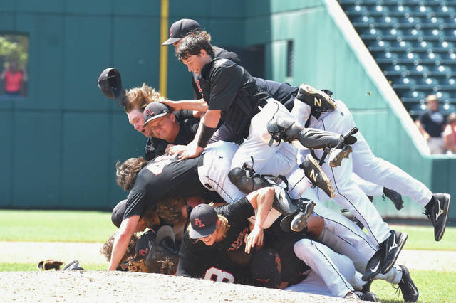 Fort Loramie players form a pile after defeating Hicksville 8-4 in the Division IV state championship game on Feb. 2 at Huntington Park in Columbus. The Redskins scored eight runs in the fifth inning to battle back from an early 4-0 deficit.