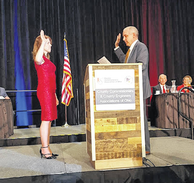 State Sen. Matt Huffman, R-Lima, issues the oath of office to Shelby County Commissioner Julie Ehemann, of Anna, as she begins her duties as president of the County Commissioners Association of Ohio board of directors.