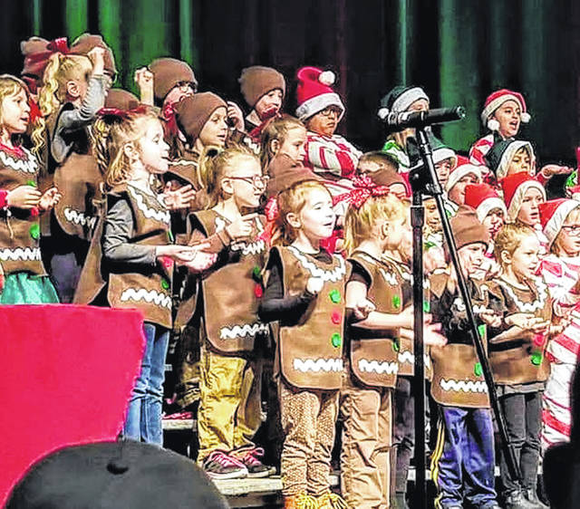 """Children in the first grade and kindergarten at Fairlawn Local Schools perform as gingerbread cookies and candy canes in """"The Great Big Holiday Bake-off,"""" recently, at the school in rural Sidney."""