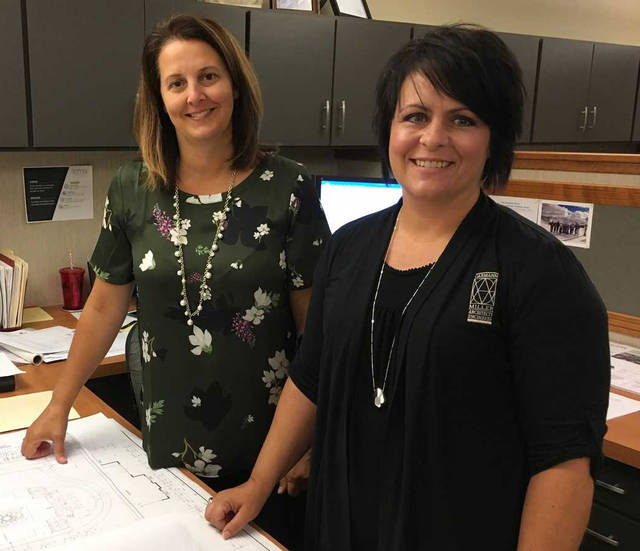 Garmann/Miller architects Mandy Niekamp, left, and Kasey Corbet have acted as administrators on 22 of the firm's LEED projects.