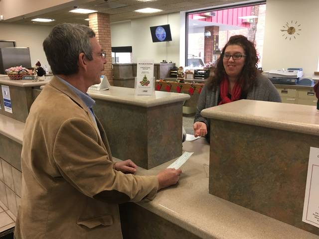 With check in hand, Fourth Ward Sidney City Councilmember Steve Wagner attempts to purchase a Shelby County Bicentennial silver coin, only to be told by Mutual Federal Branch Manager Diana Paulus that the coins are sold out. Like Wagner, there were apparently a number of individuals who did not preorder the coins who were disappointed not to be able to have one in time for Christmas.
