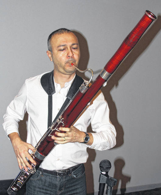 Sidney resident Omar Lozano practices playing his bassoon before a recent performance. Lozano was notified he is the recipient of the 2019 Ohio Outstanding Music Educator of the Year Award recognizing his excellence and service in musical education.