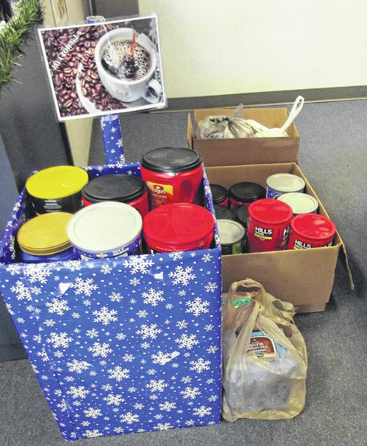 "The ""Java for G.I.'s"" drop off point at the Sidney Daily News is overflowing with all types of coffee. Donations will continue to be accepted through Dec. 31 at the newspaper."