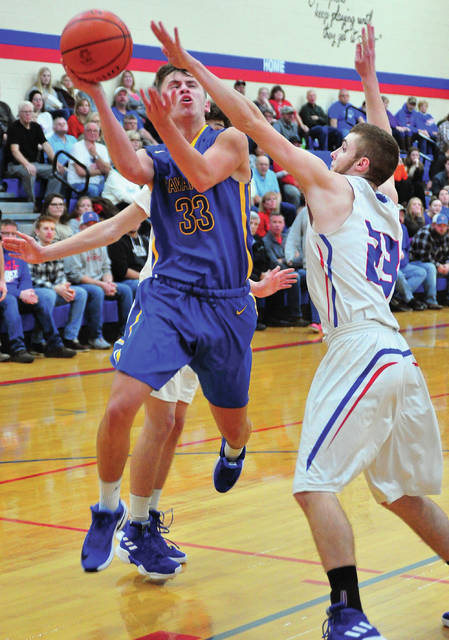 Lehman Catholic's Luke Frantz shoots over Riverside's Lane Willoby during a Northwest Central Conference game on Friday in De Graff.