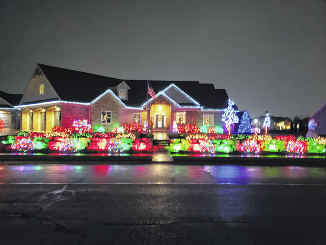 Ryan and Sarah Bollenbacher and their family, of St. Henry, were the Christmas house decorating contest winners for Midwest Electric.