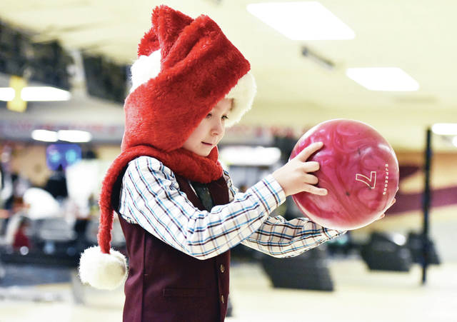 Leo Diaz, 7, of Sidney, son of Marjory Jones, bowls at the Big Brothers Big Sisters Christmas bowling party at Bel-Mar Lanes Saturday, Dec. 1. Kids got food and presents at the party.