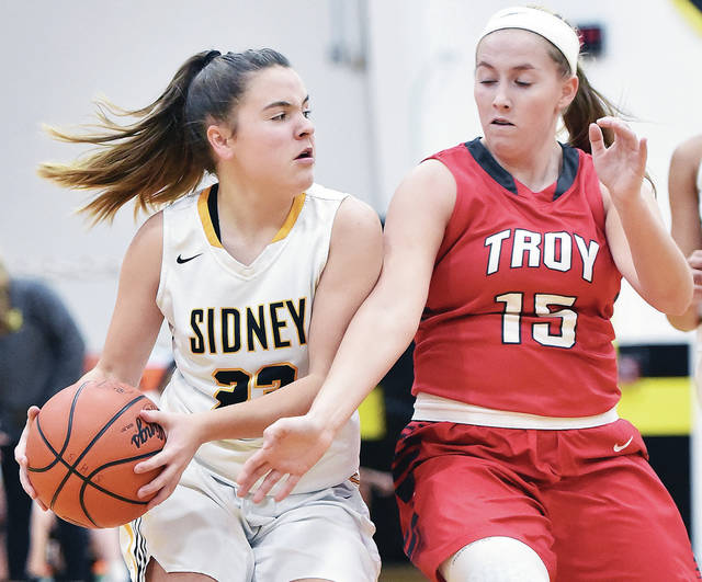 Sidney's Kelsey Kizer looks to get around Troy's Chamber Browning during a Greater Western Ohio Conference American North Division game on Wednesday in Sidney.