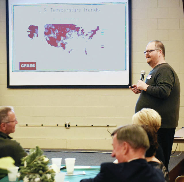 Aaron Wilson, Phd, Climate specialist with OSU Extension, discusses climate change with the attendees of the Shelby County Soil and Water 72nd Annual Report and Banquet in Fort Loramie Thursday, Dec. 6.