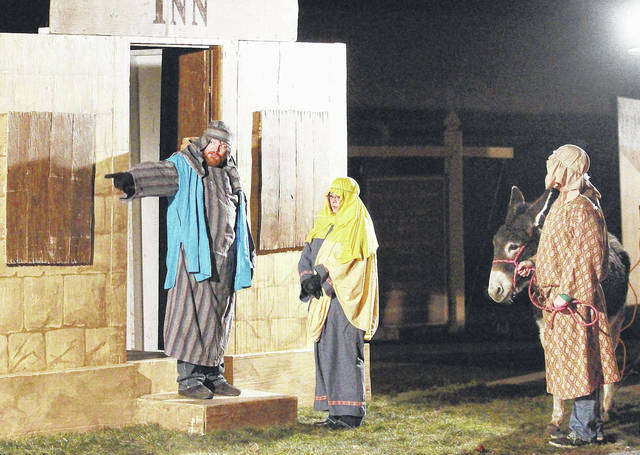 """Sidney First Church of the Nazarene congregation members perform in the 2016 live nativity drive-through program. This year's event, """"Return to Bethlehem,"""" will be Dec. 8 and 9."""