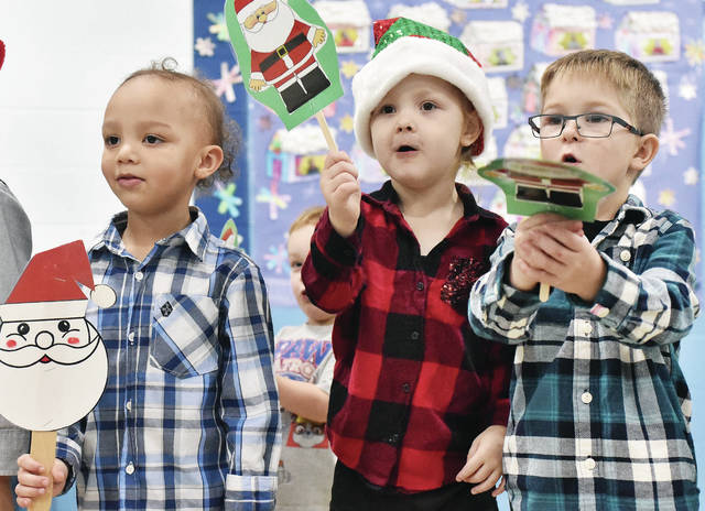 """Singing """"Where is Santa Claus?"""" are, left to right, Isaac Stockton, 4, son of Joseph and Angel Stockton, Violet Martin, 4, daughter of Paige Martin and Brandon Zumbroegel, and Crew Dunham, 5, all of Sidney, son of Brad and Joni Dunham. The three were taking part in the Shelby Hills Holiday Open House at Shelby Hills Wednesday, Dec. 12. The kids sang numerous songs, decorated tree ornaments and frosted cookies."""