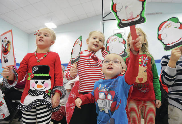 Singing Christmas songs during the Shelby Hills Early Childhood Center Christmas program in 2017 are, left to right, Brenna Davis, 5, daughter of Dallas and Bridget Davis, Maggie Clark, 5, daughter of Carrie and Chris Clark, Ryan Lawrence, 3, son of Brittany Dankworth and John Lawrence, and Aurora Smith, 5, daughter of Cheyann Berryhill, all of Sidney.