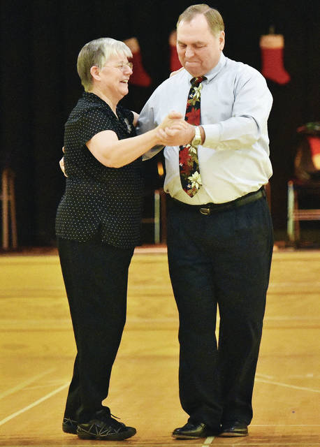 Diann Nussbaum, left, and Peter Matzig, both of Sidney, dance at the Senior Center Christmas Dance and dinner Friday, Dec. 14.