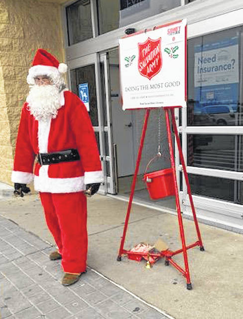 Santa Claus made a quick trip to Sidney Saturday to assist the Salvation Army with its annual Red Kettle campaign. Bell ringers will be at the kettles through Christmas Eve while Santa prepares to make his world-wide trip delivering presents to children everywhere.