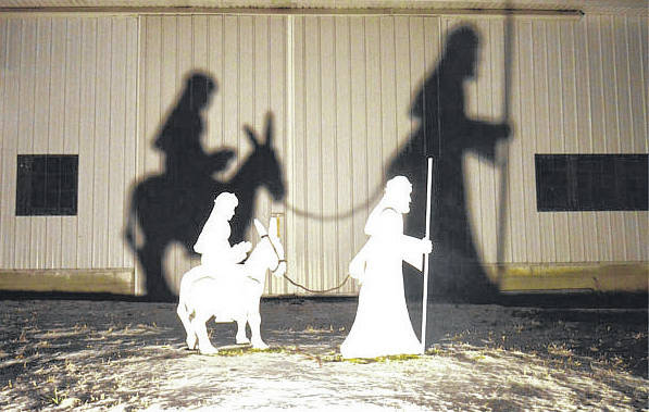 A projection of the Biblical story of the birth of Jesus includes this scene of Mary and Joseph's travels to Bethlehem. The projections are on barns along state routes 119 and 65 near Jackson Center.