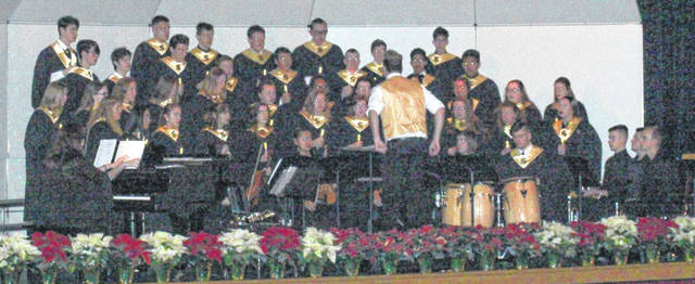 The Sidney High School Choir performs a concert of holiday songs, Monday, Dec. 17, at the school.