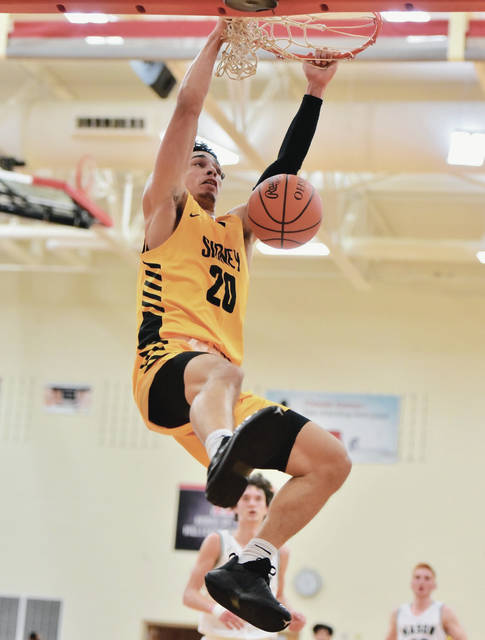 Sidney senior guard Andre Gordon dunks during a game against Mason in the Ohio Valley Hoops Classic on Saturday in Hillsboro. Gordon led Sidney with 19 points, 13 of which came in the first half.