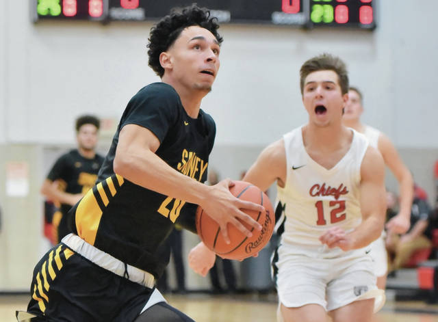Sidney's Andre Gordon breaks away while followed by Bellefontaine's Donovan Dinovo during a nonconference game on Tuesday in Bellefontaine. Gordon led Sidney with 21 points.