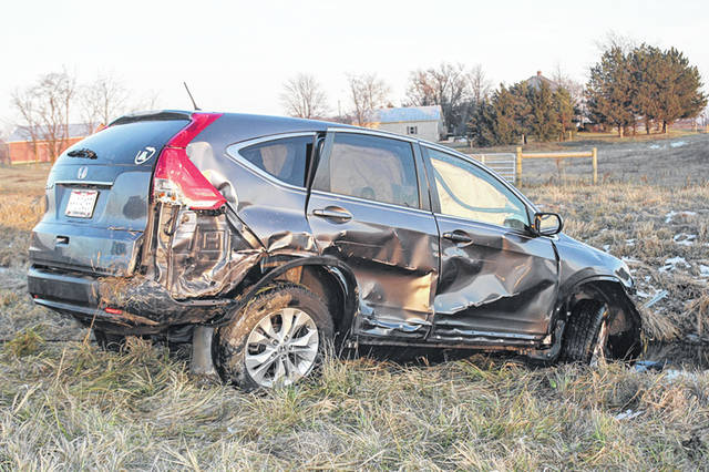 In the aftermath of a one-car crash at about 4 p.m., Tuesday, Dec. 11, the vehicle rests along Thompson-Schiff Road between Anna and Sidney. According to the Shelby County Sheriff's Office, the woman driver was traveling north on Thompson-Schiff Road and for an unknown reason, missed the stop sign at Fort Loramie-Swanders Road, swerved into and took out the guard rail and went down the embankment. Anna Rescue and Anna Fire were the first to respond to the scene. The Shelby County Sheriff's Office also responded. The driver was transported to Wilson Memorial Hospital. The crash remains under investigation.