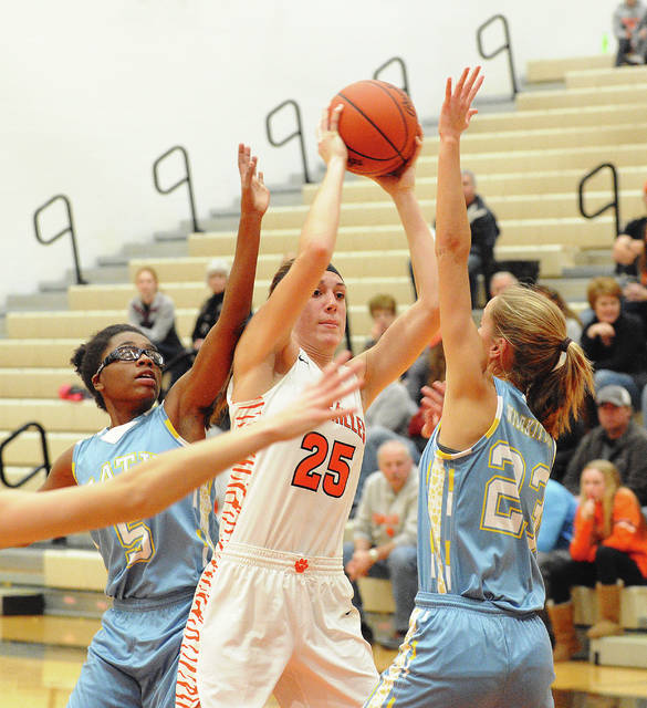 Versailles Lindsey Winner is pressured by Lima Bath's Ja'Dasia Hardison, left, and Ruby Bolon, right, during a nonconference game on Monday at Versailles.