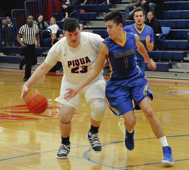 Piqua's Riley Hill dribbles with pressure from Lehman Catholic's Brendan O'Leary during the WPTW Classic on Thursday at Garbry Gymnasium in Piqua.