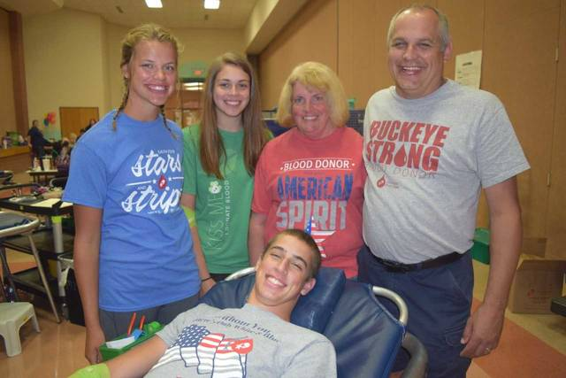 Kelly Schmitmeyer, center, at the July Anna Rescue Squad blood drive, with daughters, left to right, Mindy and Jodie, husband, Gary, and son, Ben, donating.