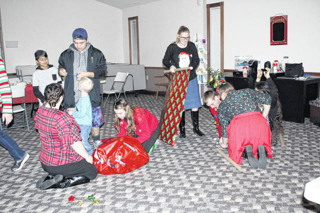 Voltage Youth Ministries celebrated Christmas on Friday, Dec. 21, by decorating cookies and wrapping human gifts in a 3 minute contest. The group is a member of the Sidney Apostolic Temple.