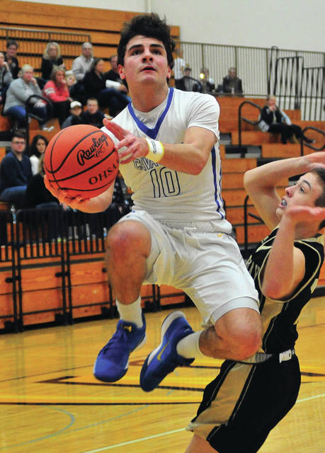 Lehman Catholic's Elliott Gilardi soars to the hoop during a nonconference game against Parkway on Saturday in Sidney.
