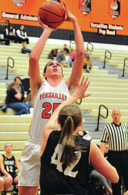Versailles' Lindsey Winner shoots over Parkway's Claire Eichler during a Midwest Athletic Conference game on Thursday in Versailles.