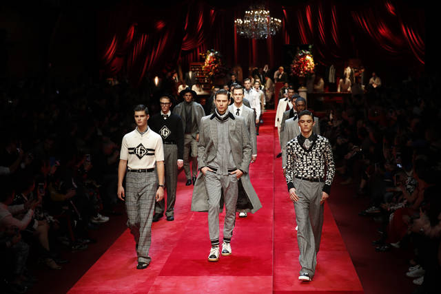 Models wear creations as part of the Dolce & Gabbana men's Fall-Winter 2019-20 collection, that was presented in Milan, Italy, Saturday, Jan.12, 2019. (AP Photo/Antonio Calanni)