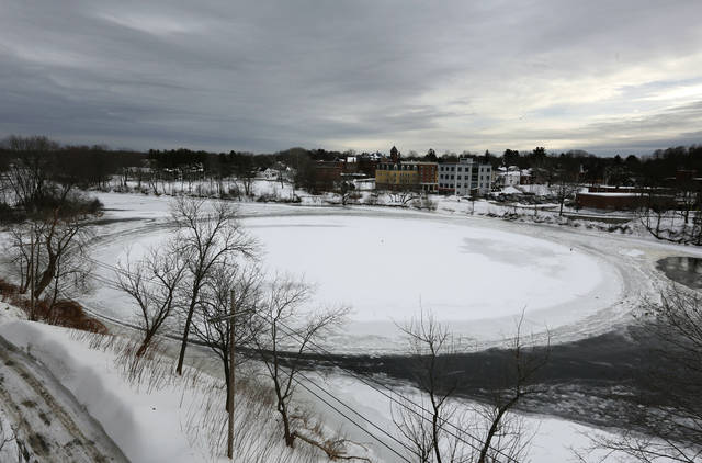 A naturally occurring ice disk that gained international fame appears to be freezing in place following a stretch of frigid weather, Wednesday, Jan. 23, 2019, in Westbrook, Maine. The giant ice disk on the Presumpscot River now has its own webcam.
