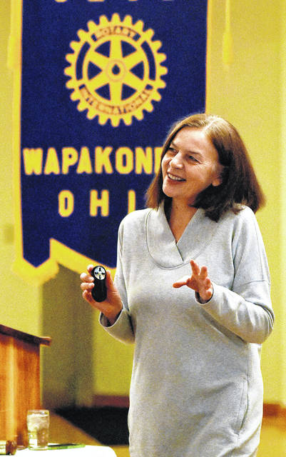 "Simone Thomas, wife of retired astronaut Dr. Don Thomas, addresses a slide presentation on entitled ""An Astronaut Wife's Life,"" during the Wapakoneta Rotary Club's noon lunch meeting held at the Wapakoneta Eagles on Monday."