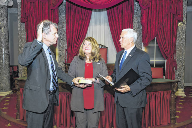 Vice President Mike Pence, right, swears in Sherrod Brown, left, for a third term as one of Ohio's two senators while Brown's wife, Connie Schultz, holds the Bible, in Washington, D.C., recently.