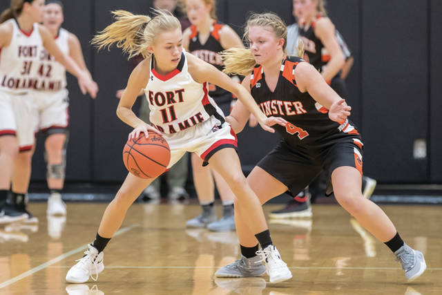 Fort Loramie's Caitlyn Gasson, left, tries to work her way past Minster's Ivy Wolf during a nonconference game in Fort Loramie on Jan. 12. The Redskins and Wildcats are ranked Nos. 1 and 2, respectively, in Division IV.