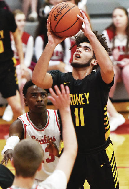 Sidney's Keith Lee shoots shoots during a Greater Western Ohio Conference crossover game against Stebbins on Tuesday in Riverside. Lee scored a career-high 16 points in the game.