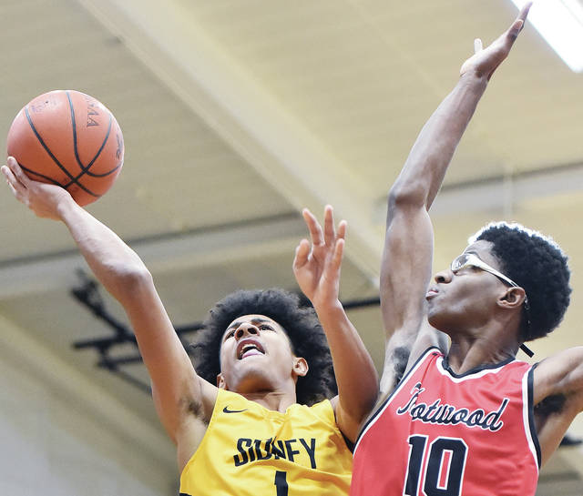 Sidney's Dominick Durr shoots as Trotwood's Terrence Gates defends during a Greater Western Ohio Conference American North Division game on Friday in Sidney.