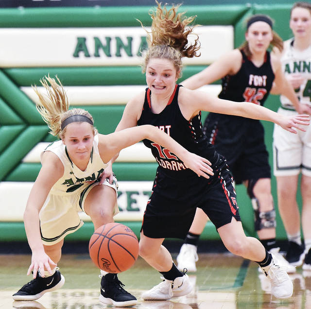Anna's Ella Doseck and Fort Loramie's Kennedi Gephart dive for a loose ball during a Shelby County Athletic League game on Jan. 3 in Anna. The teams will meet again on Saturday in Fort Loramie. The Redskins are ranked No. 1 in Division IV in this week's state AP poll.