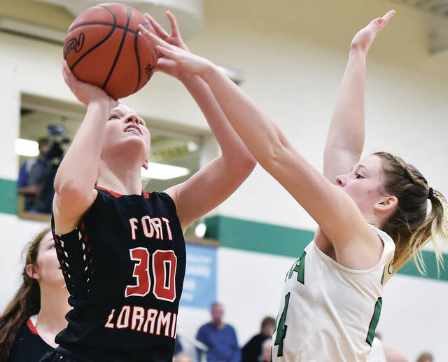 Fort Loramie's Dana Rose shoots as Anna's Kiplyn Rowland defends at Anna Thursday.