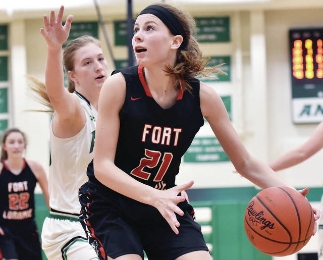 Fort Loramie's Ava Sholtis drives around Anna's Lauren Barhorst during a Shelby County Athletic League game last Thursday in Anna. The Redskins are ranked No. 2 in Div. IV.