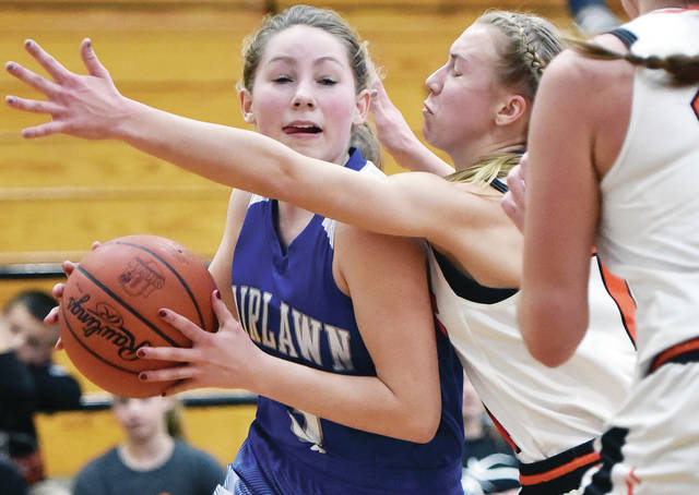 Fairlawn's Lonna Heath drives past Jackson Center's Ashley Mullenhour during a Shelby County Athletic League game on Saturday in Jackson Center.