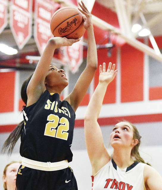 Sidney's Samantha Reynolds shoots as Troy's Payton Riley defends during a Greater Western Ohio Conference American North Division game on Wednesday in Troy. Reynolds led Sidney with 13 points.