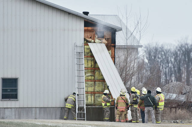 Firefighters remove siding from an outbuilding on the 900 block of Versailles Road just west of Russia around 4:40 p.m. Thursday, Jan. 31. The fire was inside the buildings walls and was quickly knocked down by firefighters. Firefighters from Russia, Versailles and Houston responded. The Shelby County Sheriff's Office also responded.