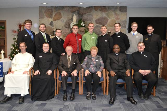 Catholic seminarians and religious from the north deaneries of the Archdiocese of Cincinnati recently received scholarships from the Darke County Foundation. Front row: Br. Bernard Knapke, St. Henry; Patrick Blenman, Sidney; Melvin and Mary Ann Stucke, Versailles (donors); Deacon Elias Mwesigye, Botkins; Deacon Zach Cecil, Piqua. Back row: Greg Evers, St. Rose; Lee Rosenbeck, Russia; Zacharias Schoen, Celina; Kraig Gruss, Coldwater; Brice Berger, Yorkshire; Loren Hein, Celina; Ethan Hoying, Russia; Max Travis, New Bremen; Aaron Hess, Philothea. Not pictured: Sister Mary Xavier Schulze, McCartyville; Sister Monica Marie Slonkosky, Minster; Elijah Puthoff, Russia; David Slonkosky, Minster; James Walters, Sidney.