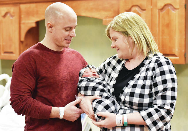 Kyle, left, and Alyssa Barlage, both of Russia, look at their baby girl Ashton Barlage who was the first baby born in 2019 at the Copeland-Emerson Family Birth Center at Wilson Health Tuesday, Jan. 1 at 2:32 a.m. Ashton weighed 8 pounds 1 ounce and measured 20 inches. The couple were presented numerous gifts from the Wilson Health Gift Shop and the Wilson Health Sweet Beginnings Lactation Boutique and a gift card from Picture Perfect Studios. Babies born at Wilson Health can be seen at www.wilsonhealth.org and click on the Baby Photos link.