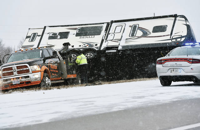 A camper trailer is turned upright after it flipped onto its side in the median of Interstate 75 just south of the 25A exit Thursday, Jan. 10, around 9 a.m.. Mantor Auto and Truck Repair lifted the camper back onto its tires. The OSP responded to the crash.