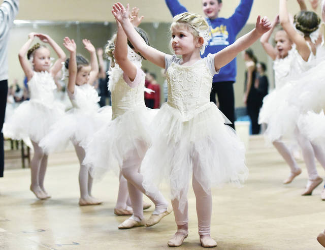 Elizabeth Wolaver, front, 4, of Piqua, daughter of Thomas and Kris Wolaver, plays the part of a baby swan.
