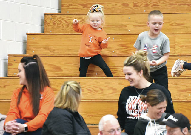 Emry Shuster, top, 2, of Jackson Center, daughter of Tara and Ben Shuster, dances to music during the Jackson Center vs Russia girls basketball game. The game was held at Jackson Center Thursday, Jan. 10.